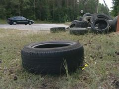 Used tires eliminated at roadside. Cars going. Stock Footage