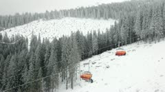 Chairlift in snowy winter mountains Stock Footage