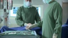 Medium shot tilt up of two surgeons operating Stock Footage