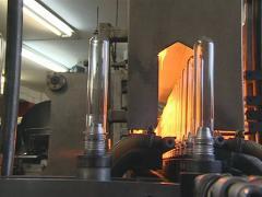 PET bottle factory. Recycling plastics. Plastic is heat blowing - stock footage