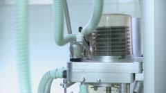 Close-up lockdown shot of a ventilator moving up and down - stock footage