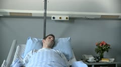 Lockdown, Medium shot, of a woman visiting a friend in hospital Stock Footage