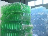 Stock Video Footage of Packaged distinct color PET bottles. Recycling.