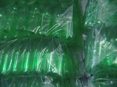 Piles of packaged green PET bottles in warehouse plastic recycling factory. Stock Footage