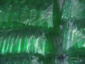 Stock Video Footage of Piles of packaged green PET bottles in warehouse plastic recycling factory.