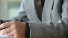 CU, SELECTIVE FOCUS, Businessman gesturing at conference table, mid section - stock footage