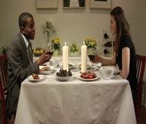 Medium lockdown shot of a man and woman having a romantic dinner together, side Stock Footage