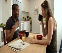 MS, Couple having breakfast in a kitchen Stock Footage