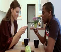 MS lockdown of a man and woman sitting at a table using their mobile phones, Stock Footage