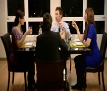 WS, Lockdown, Four friends having a dinner party toasting their glasses Stock Footage