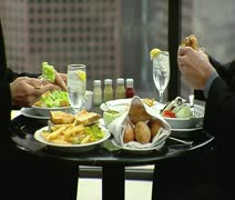 CU, Lockdown, Midsection, Two businessmen eating lunch at a hotel dining table Stock Footage
