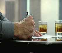 CU, TS, Midsection, A businessman writing a check and sliding it across a table Stock Footage