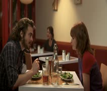 MS, Lockdown, Focus on Foreground, A man and a woman in a cafe when the woman Stock Footage