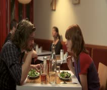 MS, Lockdown, Focus on Foreground, A man and a woman eating dinner in a cafe Stock Footage