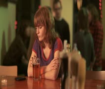 MS, PAN, Young woman getting a text message while sitting alone in a bar, Stock Footage