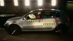 WS, Lockdown Side View shot of a technician inspecting a crash test car Stock Footage