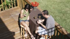 HA, MS of a couple drinking wine and using their smart phones - stock footage