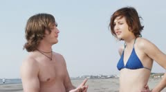 SLO MO, MS, Lockdown of a young couple arguing on the beach Stock Footage