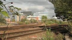 Train heading towards with Manchester in background Stock Footage