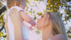 Portrait of Blonde Mother and Baby - stock footage