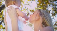 Portrait of Blonde Mother and Baby Stock Footage
