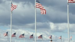 CU of one man suspiciously passing a document another in front of American flags Stock Footage