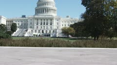 SLO MO, MS of two well-dressed men walking towards the US Capitol Building, - stock footage
