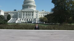 SLO MO, MS of a well-dressed man running from the US Capitol Building, Stock Footage