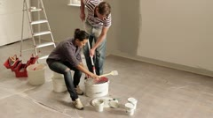 Stock Video Footage of WS, TU of a young couple renovating their living room
