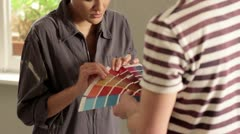 CU, TU of a young couple deciding what color to paint their living room Stock Footage
