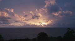 T/L, WS, Lockdown, View of the sun setting over the sea Stock Footage