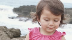 Close-up of a young girl smiling on a beach Stock Footage