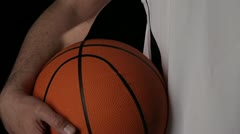 CU, TU, Basketball player with cut and nosebleed holding a basketball Stock Footage