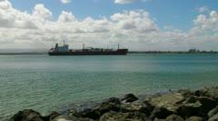 Fuel gasoline petrol tanker cargo ship leaves San Juan harbor Stock Footage