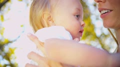 Mother and Smiling Baby in Close up Stock Footage