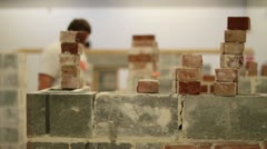 Bricks in foreground mason DOF Stock Footage