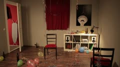 WS, Lockdown of a young couple in their living room after a party Stock Footage