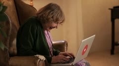 MS, Lockdown of a senior woman using a laptop Stock Footage