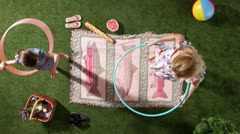 MS, Lockdown, mother and daughter hula hooping at the park, overhead view Stock Footage