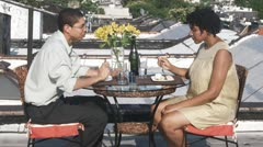 MS, Lockdown, A couple eating a meal on a rooftop terrace Stock Footage