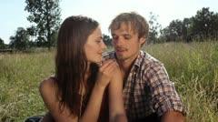 CU, Handheld, young woman feeding her boyfriend a cherry Stock Footage