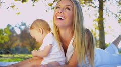Beautiful Young Mother with her Baby Son - stock footage