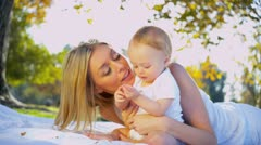 Beautiful Mother and Young Child Outdoors - stock footage