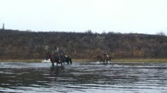 Riding Horses Across River Stock Footage