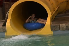 Girl Going Down Water Slide on a Tube Stock Footage