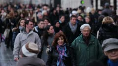 Crowd walking down street Stock Footage