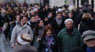 Crowd walking down street Stock Footage