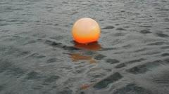 Orange Buoy marker float Stock Footage