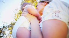 Cute Baby and Mom Playing Outdoors - stock footage