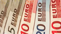 European finance. Zoom out from a closeup of turning Euro bank notes. Stock Footage